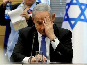 Israeli Prime Minister Benjamin Netanyahu gestures as he speaks during a meeting of the right-wing bloc at the Knesset (Israeli parliament) in Jerusalem on November 20, 2019. GALI TIBBON / AFP