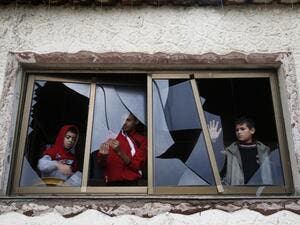 Palestinian boys pull shards of glass from a broken window at their home near the site of Israeli overnight attacks in Gaza City on December 8, 2019. (AFP/ File Photo)