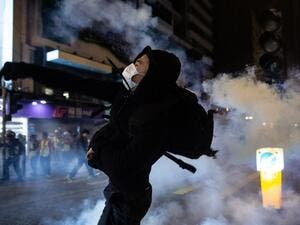 A protester reacts after police fire tear gas to disperse bystanders in a protest in Jordan district in Hong Kong, on early December 25, 2019. (AFP/ File Photo)