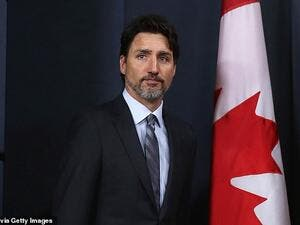 Canadian prime minister Justin Trudeau (pictured) has today blamed the US 'escalation' in the Middle East for the Iranian shoot-down of a passenger jet. (AFP)