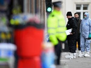 Police forensic officers work outside of a Boots store on Streatham High Road in south London on February 3, 2020, after a man was shot dead by police on February 2, following reports he had stabbed two people. AFP