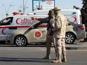 Members of the Libyan security forces man a checkpoint in the capital Tripoli, to insure that the strict measures taken by the authorities to stem the spread of the novel coronavirus are respected, on April 10, 2020. Mahmud TURKIA / AFP
