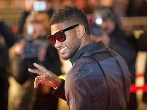 Usher on the red carpet of NRJ Music Award 2011 during the Midem. (Shutterstock/ File Photo)