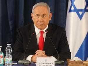 "Israeli Prime Minister Benjamin Netanyahu chairs the weekly cabinet meeting in Jerusalem on June 7, 2020. Netanyahu urged world powers to reimpose tough sanctions against Iran, vowing to curb Tehran's regional ""aggression"" hours after another deadly strike on pro-Iranian fighters in Syria. Menahem KAHANA / AFP"