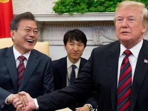 US President Donald Trump and South Korean President Moon Jae In shake hands during a meeting in the Oval Office of the White House. (AFP)