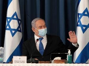 Israeli Prime Minister Benjamin Netanyahu wears a protective mask as he opens the weekly cabinet meeting at the foreign ministry in Jerusalem on July 5, 2020. GALI TIBBON / POOL / AFP