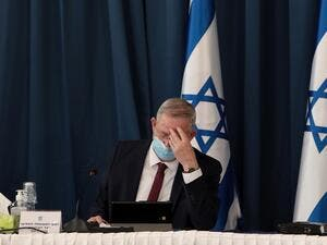 Israeli defence minister and alternate prime minister Benny Gantz wears a protective mask as he attends the weekly cabinet meeting at the foreign ministry in Jerusalem on July 5, 2020. GALI TIBBON / POOL / AFP