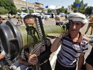 A Yemeni gunman loyal to the Huthi movement brandishes an anti-tank weapon during a rally in the capital Sanaa, to show support to the movement against the Saudi-led intervention in the country on July, 7, 2020. Mohammed HUWAIS / AFP