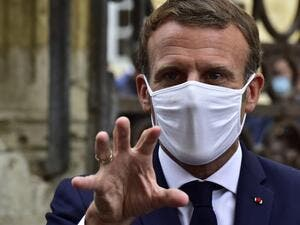 "French President Emmanuel Macron, wearing a protective face mask, speaks to the journalists during a visit at the Polignac castle on September 18, 2020 in Condom, on the eve of the European Heritage Days and the third edition of the ""Loto du Patrimoine"" lottery draw aiming at help restoring heritage sites at risk. GEORGES GOBET / AFP / POOL"
