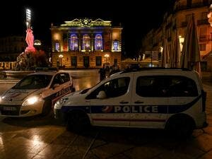 French Police officers stand next to their cars in Montpellier on October 17, 2020, as a curfew is in place to fight the spread of Covid-19. About 20 million people in the Paris region and eight other French cities were facing a 9 pm-6 am curfew from October 17, after cases surged in what has once again become one of Europe's major hotpots. Pascal GUYOT / AFP