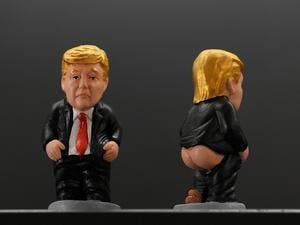 "A picture shows typical Catalan ceramic figurines called ""caganers"" (poopies) depicting US President Donald Trump in Barcelona on October 22, 2022. Statuettes of well-known people defecating are a strong Christmas tradition in Catalonia, dating back to the 18th century as Catalans hide ""caganers"" in Christmas Nativity scenes and invite friends to find them. LLUIS GENE / AFP"