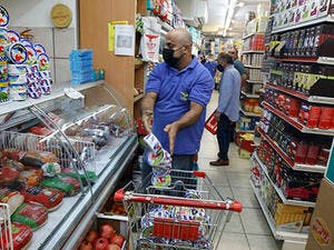 A worker removes french goods from the shelves of a supermarket in the Arab neighbourhood of Beit Hanina in Israeli-annexed east Jerusalem on October 26. (AFP)