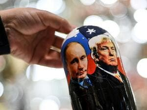 A vendor shows a traditional Russian wooden nesting doll, Matryoshka doll, depicting Russia's President Vladimir Putin and US President and Republican presidential nominee Donald Trump at a gift shop in central Moscow on November 3, 2020. Kirill KUDRYAVTSEV / AFP
