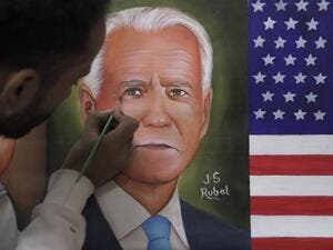 A painter gives the final touches to a painting depicting newly elected US President Joe Biden, in Amritsar on November 8, 2020. NARINDER NANU / AFP