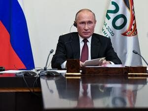 Russian President Vladimir Putin attends the G20 summit hosted by Saudi Arabia via video conference at the Novo-Ogaryovo state residence, outside Moscow, Russia, on November 21, 2020. AFP