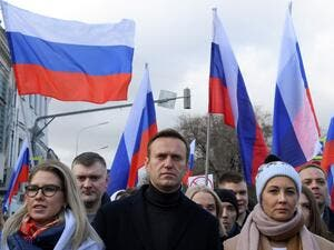 In this file photo taken on February 29, 2020 Russian opposition leader Alexei Navalny, his wife Yulia, opposition politician Lyubov Sobol and other demonstrators take part in a march in memory of murdered Kremlin critic Boris Nemtsov in downtown Moscow on February 29, 2020. Navalny, 44, was hospitalised in the Russian city of Omsk after he collapsed on a flight from Siberia to Moscow in August 2020 and then transported by medical aircraft to Berlin. Chemical weapons experts from Russia's Federal Security