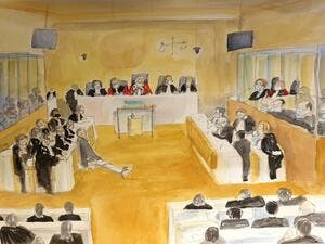 This court sketch made on December 16, 2020 shows a general view at the Paris courthouse during the sentencing hearing in the trial of 14 suspected accomplices of the Islamist gunmen who murdered seventeen people over three days of attacks in January 2015, beginning with the massacre of 12 people at the satirical weekly Charlie Hebdo. Marie WILLIAMS / AFP