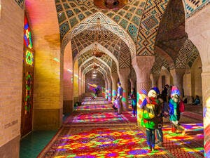 Lot of tourists taking photos in the interior of Nasir Al-Mulk Mosque (Pink Mosque) with colorful shining stained glass windows. (Shutterstock/ File Photo)