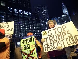 A small group of demonstrators protest near Trump Tower on January 07, 2021 in Chicago, Illinois. They called for the removal of President Donald Trump from office after a pro-Trump mob stormed the Capitol building in Washington, DC yesterday as lawmakers met to count the Electoral College votes in the presidential election. Scott Olson/Getty Images/AFP