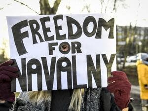 A demonstrator demanding the release of the detained Russian opposition leader Alexei Navalny holds a placard outside the Russian embassy in Stockholm, Sweden, on January 23, 2021. The 44-year-old Chief Kremlin critic Alexei Navalny was arrested at his return in Moscow after spending several months in Germany recovering from a poisoning attack that he said was carried out on the orders of President Vladimir Putin Fredrik SANDBERG / TT News Agency / AFP