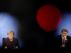 German Chancellor Angela Merkel (L) and Bavarian State Premier Markus Soeder (R) hold a news conference following talks via video conference with Germany's state premiers on the extension of the current lockdown due to the coronavirus COVID-19 pandemic, at the Chancellery in Berlin, on February 10, 2021. Markus SCHREIBER / POOL / AFP