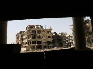A general view shows destroyed buildings in the former rebel-held Syrian town of Douma on the outskirts of Damascus on Apr. 19, 2018, five days after the Syrian army declared that all anti-regime forces have left Eastern Ghouta, following a blistering two month offensive on the rebel enclave. The regime in February launched a blistering assault on Eastern Ghouta, a semi-rural area within mortar range of central Damascus that had been in opposition hands for six years. (STRINGER / AFP)