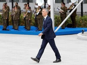 NATO Secretary General Jens Stoltenberg walks during the opening ceremony of the NATO (North Atlantic Treaty Organization) summit, at the NATO headquarters in Brussels, on July 11, 2018. 