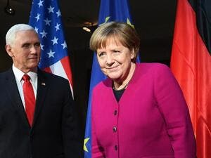 German Chancellor Angela Merkel (R) and US Vice President Mike Pence pose during a photo call at the 55th Munich Security Conference in Munich, southern Germany, on February 16, 2019. The 2019 edition of the Munich Security Conference (MSC) takes place from February 15 to 17, 2019. 