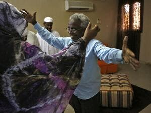 Osman Mirghani (R), editor-in-chief of independent daily Al-Tayar, is greeted by his sister following his release from jail at his home in the Sudanese capital Khartoum's twin city of Omdurman, on March 29, 2019. (AFP)