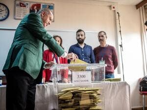 Turkish President Tayyip Erdogan (L) casts his ballot at a polling station during the municipal elections in Istanbul, on March 31, 2019. Turkey voted in local elections in a test for President Recep Tayyip Erdogan, with his ruling party risking defeat in the capital as an economic slowdown takes hold.