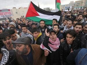 Protesters shout slogans and wave the Jordanian flag during a demonstration near the American Embassy in Amman against U.S. President Donald Trump's decision to recognise Jerusalem as the capital of Israel. (KHALIL MAZRAAWI / AFP)