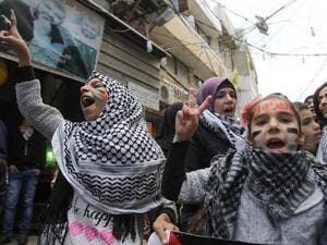 Palestinian women and children take part in a protest in the refugee camp of Ain el-Helwe on the outskirts of the southern Lebanese port city of Sidon Dec. 8, 2017 to denounce the widely criticised U.S. decision to recognize Jerusalem as the capital of Israel (Mahmoud Zayyat/AFP)