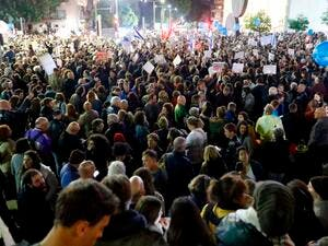 "Approximately 25,000 people met in Rothschild Boulevard to protest Netanyahu with placards that say ""No to Corruption,"" ""Not leftist, not rightist, we are honest,"" ""Get out Netanyahu"" (AFP)"