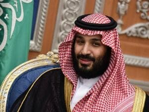 Muhammad bin Salman not happy with the Merkel stance regarding Berlin's pro-Iran nuclear deal and is freezing new business links with Germany. (AFP/File Photo)