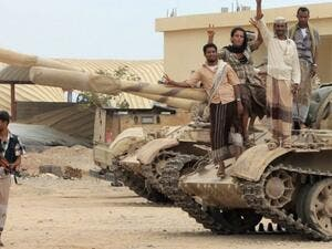Anti-Houthi militants stand on a tank in southern Yemen (AFP/File Photo)