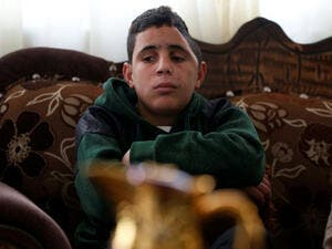 Mohammed Fadel Tamimi,Palestinian boy previously shot in the face and severely wounded by an Israeli soldiers (AFP/File Photo)