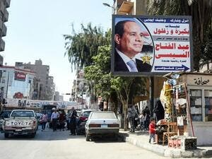 A picture shows large billboard shows a privately sponsored ad supporting Sisi (AFP/File Photo)