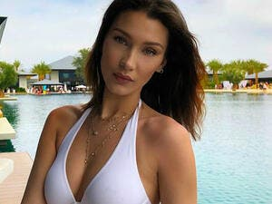 Bikini babe: Bella Hadid, 22, flaunted her envy-inducing figure in a skimpy white bikini.as she continued the scorching display while relaxing in Indio, California on Tuesday (Source: Bella Hadid - Instagram)