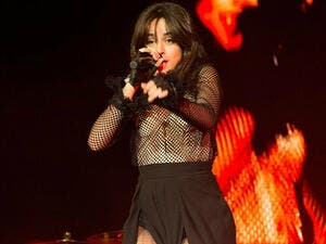 Pins on parade: Camila Cabello displayed her spectacular legs in a double split trousers as she stormed Philadelphia stage at The Fillmore (Source: REX - Shutterstock)