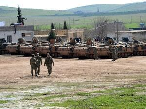 Turkish tanks wait near the Syrian border in Suruc in February 2015. (AFP/Ilyas Akengin)