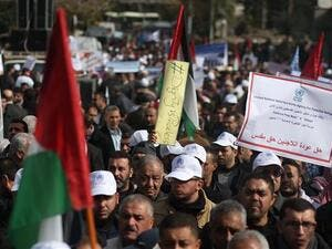 Palestinian protesters demonstrate in Gaza City on January 29, 2018 against the US move to freeze funding for a UN agency helping Palestinian refugees. (AFP)