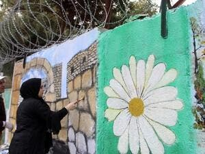 The students teamed up with professional artists to create murals that took inspiration from nature and cultural heritage. (The Daily Star/Mohammed Zaatari)