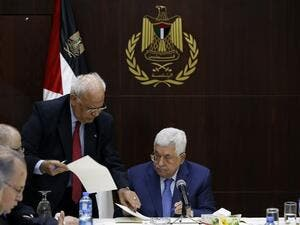 Palestinian president Mahmoud Abbas (R) speaks with Palestine Liberation Organization's Secretary General Saeb Erekat during a meeting of the Palestine Liberation Organization (PLO) (AFP)