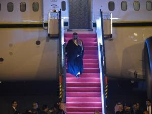 Saudi Crown Prince Mohammed Bin Salman looks on as he descends the plane upon arriving at the airport in New Delhi 