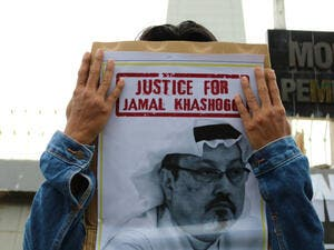 Humanitarian activists hold a poster with a picture of Jamal Khashoggi  (Shutterstock)