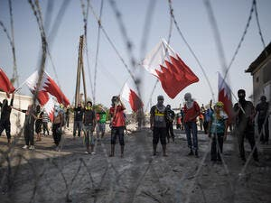 Protesters wave national flags at a demonstration in Bahrain. (AFP/File)