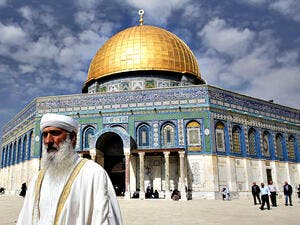 An Arab resident in front of the Dome of the Rock at Jerusalem's Al Aqsa Mosque. (Ahmad Gharabli/AFP)