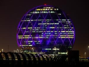 Aldar HQ building turns purple for NYUAD's fifth Commencement.