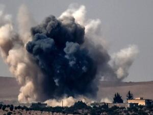 Smoke billows after an air strike on Jarablus, Syria, 24 August. (AFP/File)