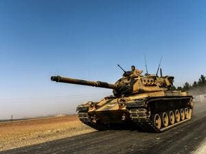 A Turkish army tank in the border city of Karkamis drives towards Syria. (AFP/Bulent Kilic)